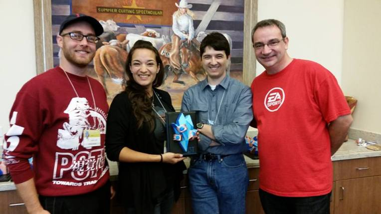 Mentors Brian Smith and Gracie Strittmatter pose with Andre Thomas and I with one of the Chillennium Trophies